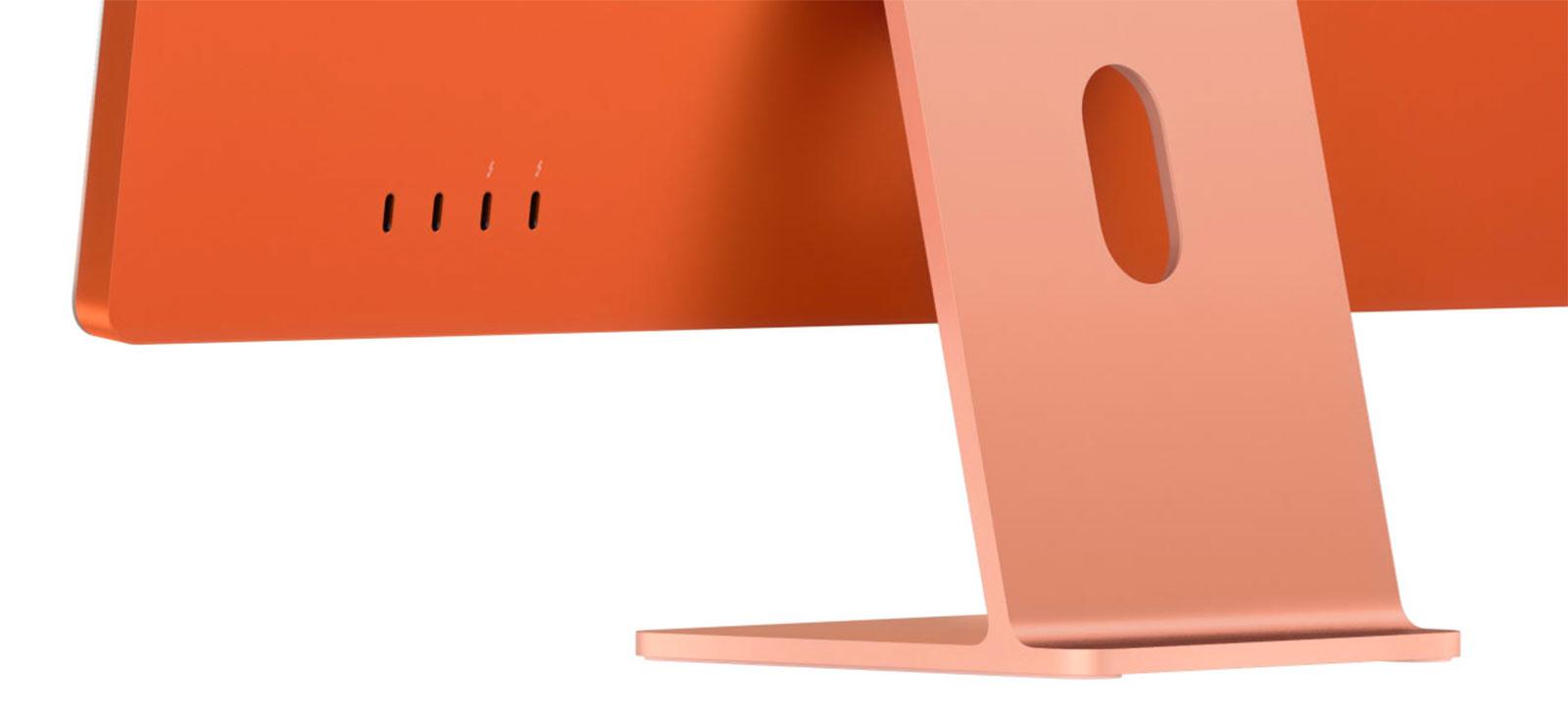 iMac Apple Silicon naranja, por detrás, con cuartro puertos USB-C